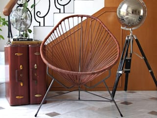 Leather Acapulco chair:   by Ocho Workshop