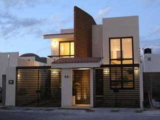 Hogar de estilo  por Arquitectura MAS