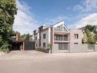 Casas modernas por in_design architektur Moderno