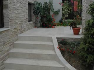 Balcones y terrazas de estilo clásico por D&L Stonedel