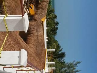 Hotel Holbox Dreams Hoteles de estilo tropical de sandro bortot arquitecto Tropical