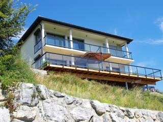 Maison neuve BBC dans les Hautes Alpes:  de style  par AAA CSC