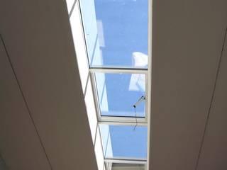 Loft: Pareti in stile  di Arch. Dario Nespoli