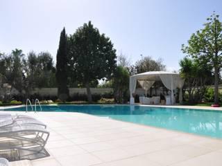 MELLOGIARDINI EXTERIOR DESIGNERS Garden Swim baths & ponds