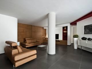 Casa L: Soggiorno in stile  di Laboratorio di Progettazione Claudio Criscione Design