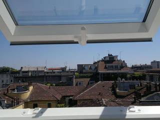 sottotetto cittadino:  in stile  di Luca Callegari Architetto / Milano