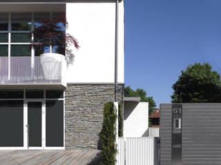 ARCHITETTURA: Case in stile  di Gariselli Associati