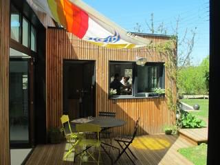 Extension bois à Sèvres:  de style  par T design architecture