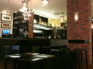 Wine bar in Novara Gastronomia in stile moderno di Alessandra Vellata Architetto Moderno