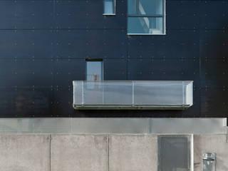 entrada a vivienda: Casas de estilo  de hollegha arquitectos