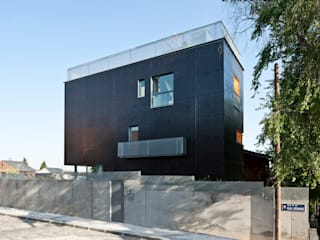 vista calle: Casas de estilo  de hollegha arquitectos