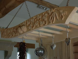 Manor house sculptural kitchen:   by Carved Wood Design Bespoke Kitchens.