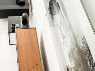 Casas de estilo moderno de TaAG Arquitectura