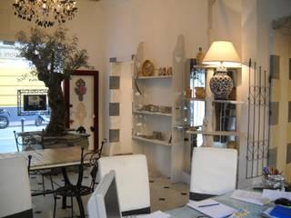 studio di progettazione d'interni Negozi & Locali commerciali in stile classico di INDUSTRIA DELL'ARTE Classico