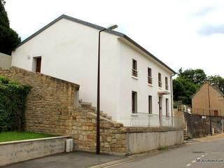 Maison de village: Maisons de style  par 3B Architecture