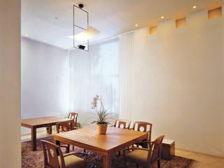 Casa 18:  de estilo  por Praxis Arquitectura