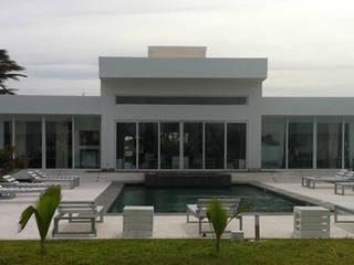 PRIVATE LUXURY VILLA in MAMBRUI di ANDREA PONTOGLIO ARCHITECT Minimalista