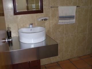 Rustic style bathroom by JRK Diseño - Studio Arquitectura Rustic