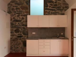 Stone Barn Conversion Jardim de Mayer & Selders Arquitectura Rústico