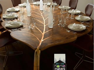 Ultra-modern and 'never seen before' art only by home makers:  Dining room by home makers interior designers & decorators pvt. ltd.