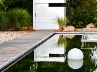 Minimalist garage/shed by design@garten - Alfred Hart - Design Gartenhaus und Balkonschraenke aus Augsburg Minimalist