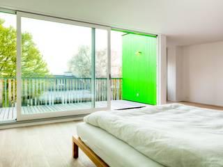 hausbuben architekten gmbh Camera da letto in stile classico