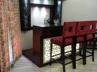 Mini bar:   by KathKarma Interior Designer & Space Planners
