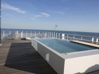Biocamini e Attico Interni al The Beach Houses:  in stile  di ATTICO INTERNI