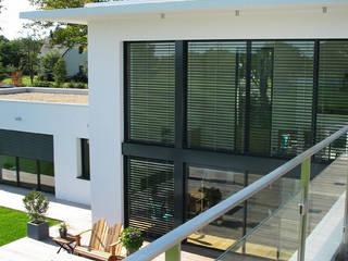 Дома в стиле модерн от ATELIER D'ARCHITECTURE ET D'URBANISME MARTIAL Модерн