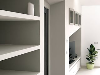 Zona living: pieni, vuoti luci ed ombre: Case in stile  di STUDIO LAR