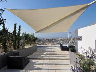 Terrace by +grün GmbH, Mediterranean