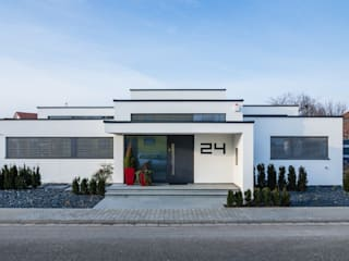 Cascade House - Single Family House in Bürstadt, Germany 現代房屋設計點子、靈感 & 圖片 根據 Helwig Haus und Raum Planungs GmbH 現代風