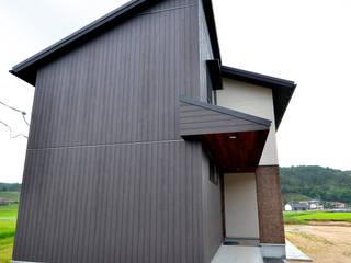 Casas de estilo moderno por 宮崎環境建築設計