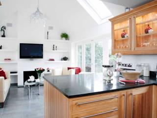 Open plan living:   by GA Interiors