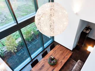 Einfamilienwohnhaus in Heppenheim Helwig Haus und Raum Planungs GmbH Moderne Esszimmer