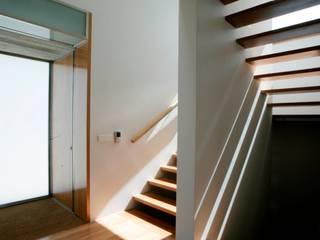 Casa GC: Casas  por Atelier Lopes da Costa