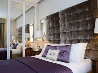 Full height mirrored wardrobes:   by GA Interiors