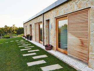 Casas de estilo  por HUGA ARQUITECTOS
