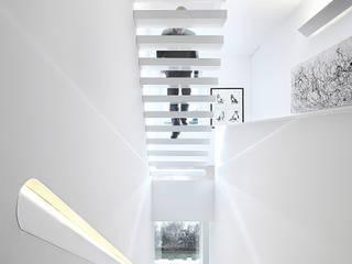 Casa José Prata: Corredores e halls de entrada  por Barbosa & Guimarães, Lda.,Moderno