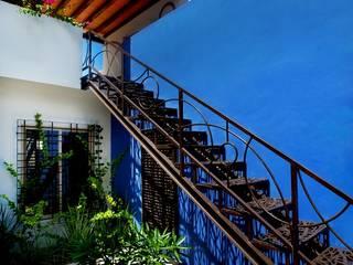 Pasillos, vestíbulos y escaleras de estilo mediterráneo de Taller Estilo Arquitectura Mediterráneo