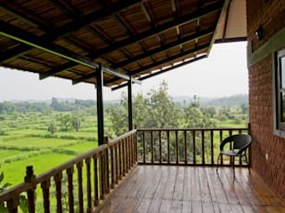 Residence at Sonale village Rustic style balcony, veranda & terrace by M+P Architects Collaborative Rustic