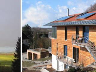 Ökohaus Steinebach, Mehrfamilienhaus am Sonnenwinkel: modern  von Planungsbüro Schilling,Modern
