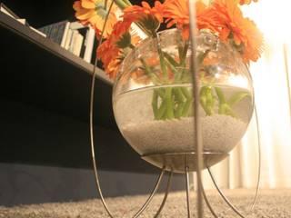 Medusa - vaso in vetro trasparente e acciaio satinato:  in stile  di Giuseppe Granata - Designer | Vincenzo Schinella - Architetto