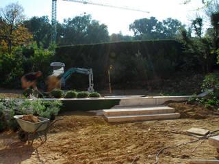 Originale zona spas:  in stile  di Pellegrini Giardini
