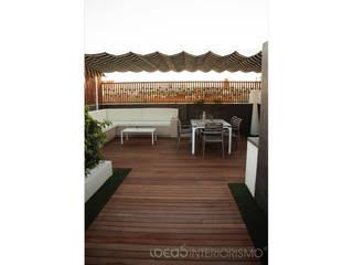 Balcones y terrazas de estilo moderno de Ideas Interiorismo Exclusivo, SLU Moderno