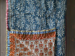 Kantha quilt made from vintage saris:   by http://www.decoratorsnotebook.co.uk/