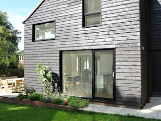 Extension and Refurbishment in Fernhurst, West Sussex by ArchitectureLIVE ArchitectureLIVE Modern home Wood Black
