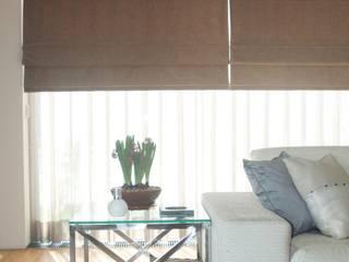 Alfragide Salas de estar modernas por Stoc Casa Interiores Moderno