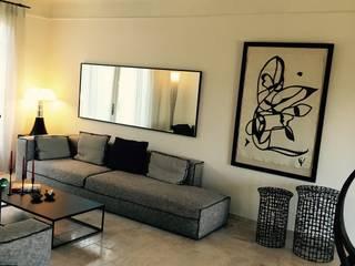 Les pierres qui roulent: Salon de style de style Moderne par RAINERI