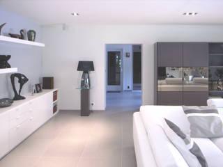Maison à Saint Vaury: Salon de style  par Jean-Paul Magy architecte d'intérieur